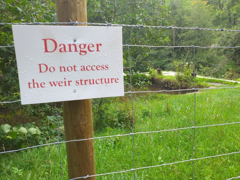 Fencing sealing off access to the the weir in the Monsal valley