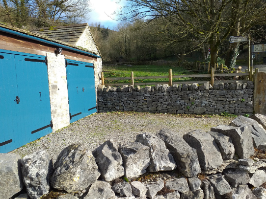 The new fencing in position at the side of the Dean Cottage double garage in Monsal Valley