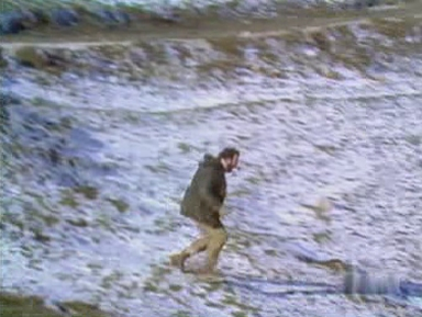 Charles plunges down the snow covered hillside