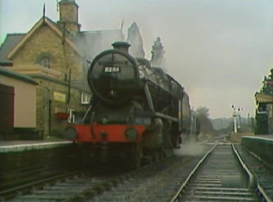 The steam train arrives at a station